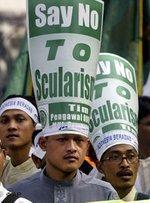 مظاهرة في جاكرتا تأييدا لقانون يحرم الإباحية، الصورة: أ ب