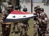 Soldiers in Iraq with the Iraqi flag (photo: AP)