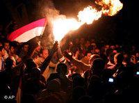 المصريون يحتفلون بفوزهم في القاهرة، الصورة أ ب