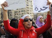 متظاهرة مصرية في ميدان التحرير، الصورة أ ب