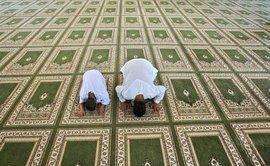 Men praying in a mosque in Ramallah (photo: AP)