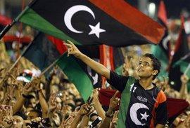 Rebels in Tripoli celebrate the end of the Gaddafi regime (photo: AP)