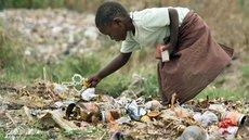 A young girl searching for food among the rubbish in Chitungwiza, Zimbabwe (photo: picture alliance/dpa)