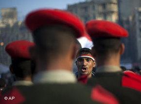 Protestor facing a military unit on Tahrir Squar, Cairo, Egypt (photo: AP)
