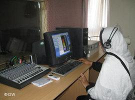 A female journalist at a radio work station in Kabul (photo: D