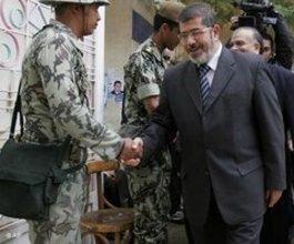 محمد مرسي المتحدث باسم الإخوان المسلمين الصورة أب
