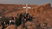 Syrian Christians celebrate Holy Cross Day at an illuminated cross in Ma'loula, Syria  in 2009 (photo: AP)