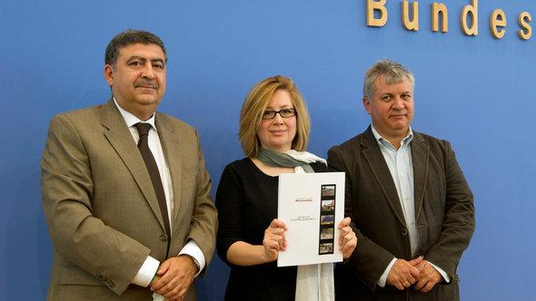 From left: Murhaf Jouejati, Afra Jalabi, and Amr al-Azm. The three Syrian dissidents present the