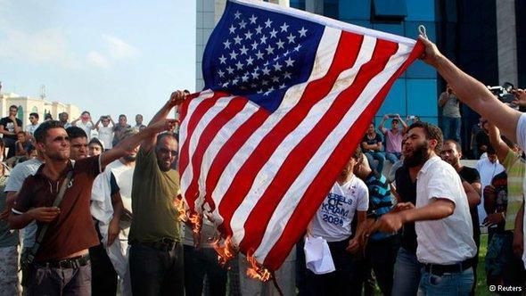 مظاهرات وحرق للعلم الامريكي