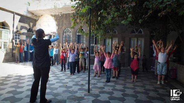 أطفال في حمص القديمة ، الصورة عدسة شاب حمصي