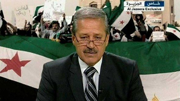 Syria's former ambassor in Iraq on Al-Jazeera (photo: Reuters)