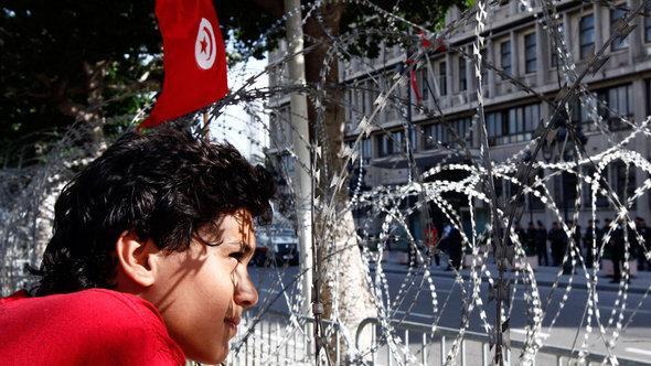 متظاهر في شارع الحبيب بورقيبة. رويترز