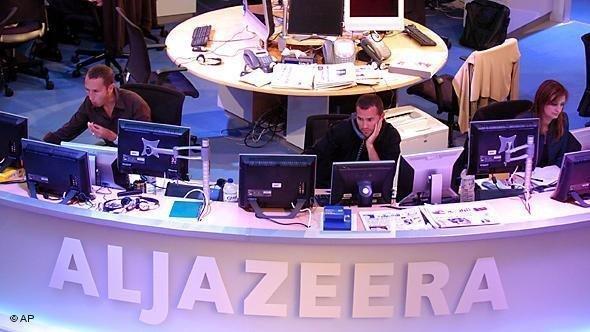 قسم التحرير في قناة الجزيرة الإنكليزية. أ ب
