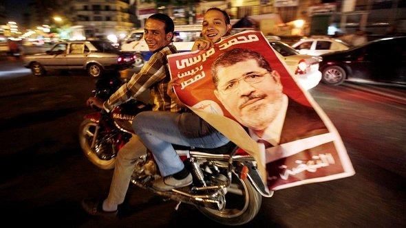 Supporters of Mohamed Mursi celebrate his victory in Egypt's presidential elections, July 2012 (photo: Reuters/Amr Abdallah Dalsh)