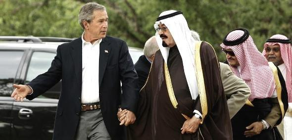 U.S. President Bush and Saudi Crown Prince Abdullah hold hands as they walk at Bush's ranch in Crawford, Texas, in this April 25, 2005 (photo: AP/Gerald Herbert)
