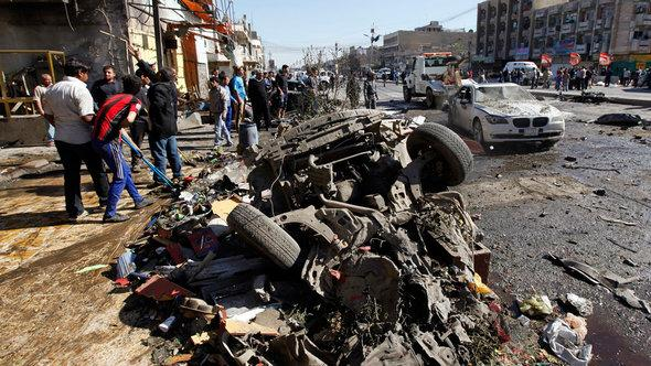 Residents gather at the site of a car bomb attack in Baghdad in March 2013 (photos: Reuters)