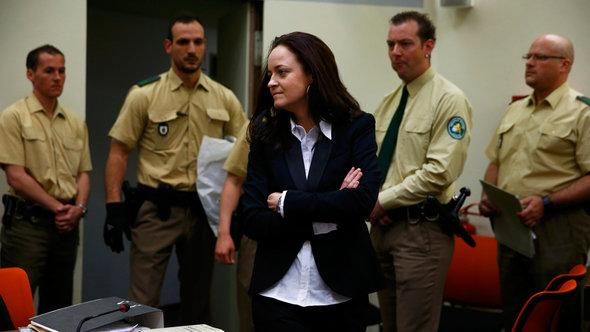 Beate Zschäpe with police officers in the court (photo: Reuters)