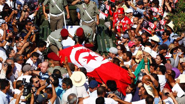 Funeral procession for Mohamed Brahmi in Tunisia (photo: Reuters)