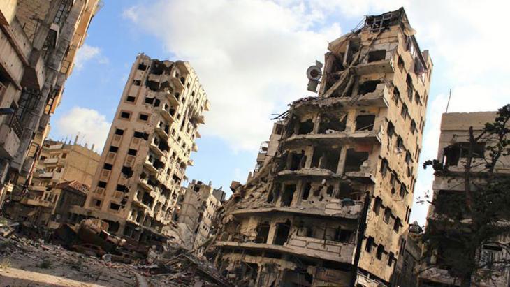 خراب ودمار في مدينة حمص وسط سوريا. photo: AP