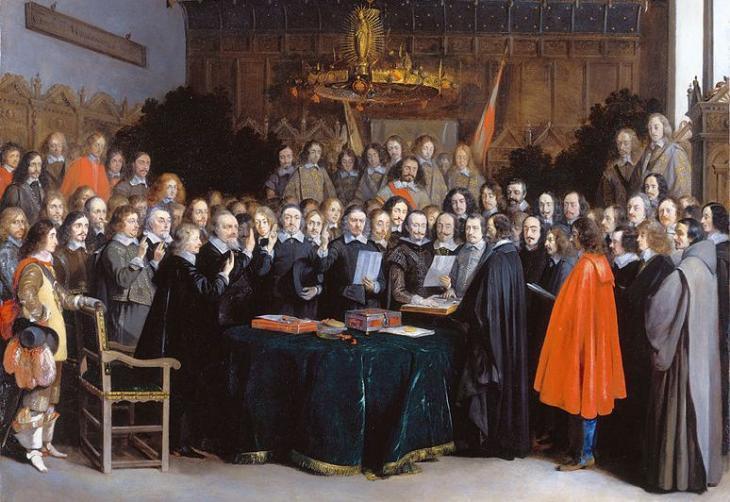 لوحة فنية رسمها هندريك تير بورش تصور اتفاقية ويستفاليا في مدينة مونستر الألمانية بين الكاثوليك والبروتيستانت الأوروبيين التي تمت في 15 مايو/ أيار 1648.   source: Wikipedia