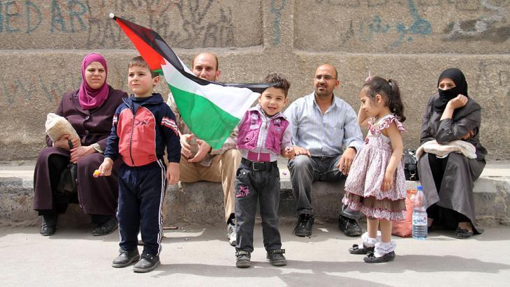لاجئون فلسطينيون في مخيم اليرموك، دمشق.  Foto: Getty Images/AFP