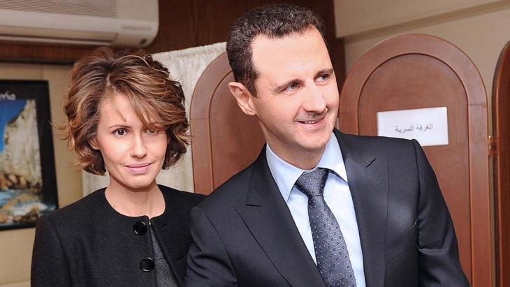 بشار وأسماء الأسد عام 2012. photo: picture-alliance/dpa