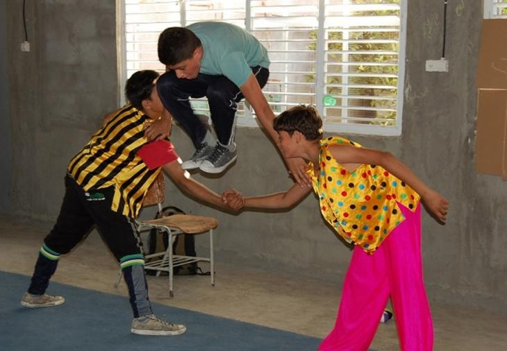Children practice a circus routine (photo: Palestinian Circus School)