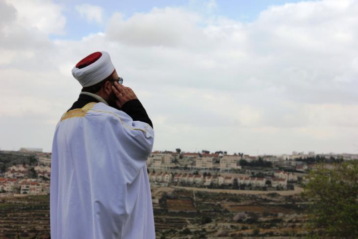 """جدارية """"هنا أرض كنعان"""" في الأراضي الفلسطينية، الصورة مهمد حامد"""