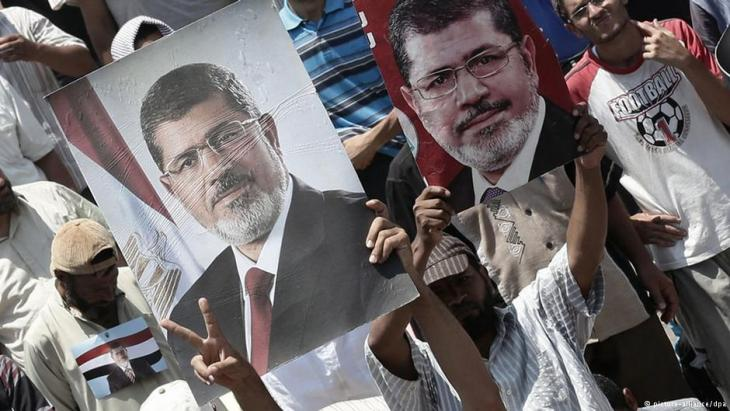 أنصار الرئيس السابق محمد مرسي في القاهرة. Foto: dpa/picture-alliance