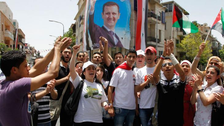 Assad supporters celebrate during an election event in Damascus (photo: Reuters/Khaled al-Hariri)