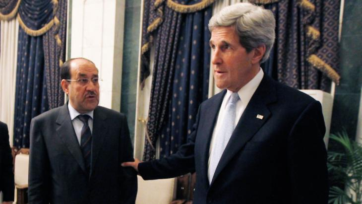 Nouri al-Maliki (left) and US Secretary of State John Kerry (photo: Getty Images)
