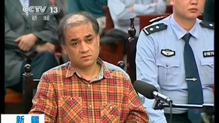 الأستاذ الجامعي الأويغوري إلهام توهتي المنتقد للحكومة الصينية  Foto: Reuters/CCTV via Reuters TV