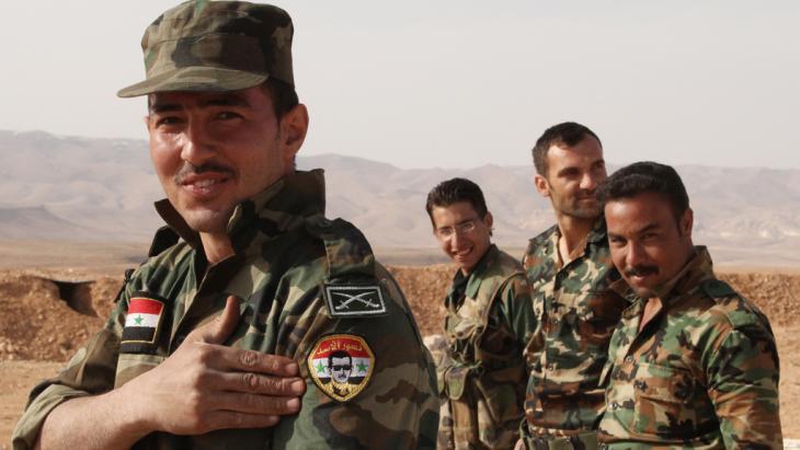 جنود موالون لنظام الأسد.  Foto: picture-alliance/dpa/Dmitriy Vinogradov