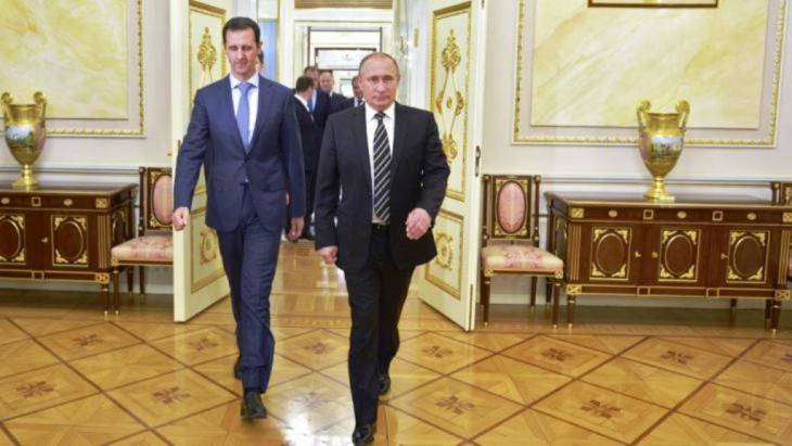 بوتين والأسد. رويترز