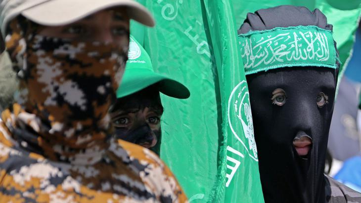 Vermummte Hamas-Mitglieder in Gaza; Foto:picture-alliance/dpa/M. Saber