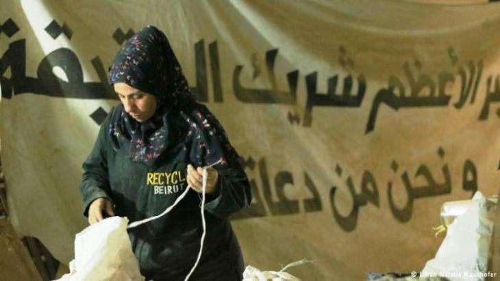 A Syrian refugee employed by Recycle Beirut sorts rubbish (photo: Natalie Mauthofer)