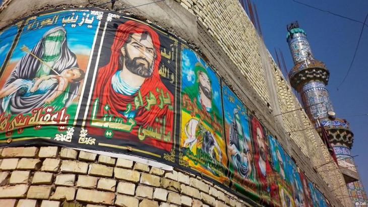صور شيعية مفترضة للإمام علي في بغداد. (photo: DW)