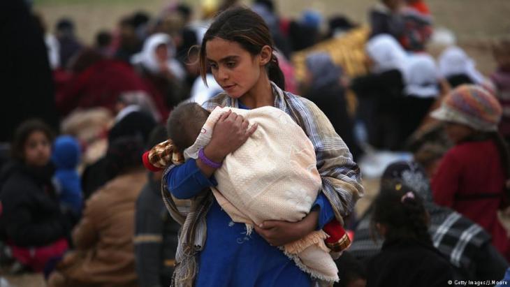 عراقيات وعراقيون فارون من داعش.