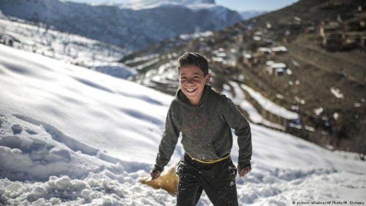 Mouhcine, 11, enjoys sledging on snow covered mountains in Tighanmin, a Middle Atlas village near Azilal, central Morocco (photo: AP Photo/Mosa'ab Elshamy)