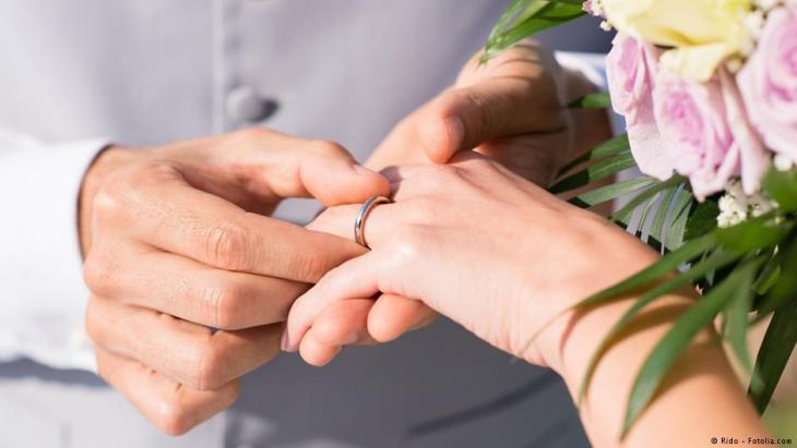 صورة رمزية لخواتم الزواج والعرس والزفاف. Foto: Rido - Fotolia.com
