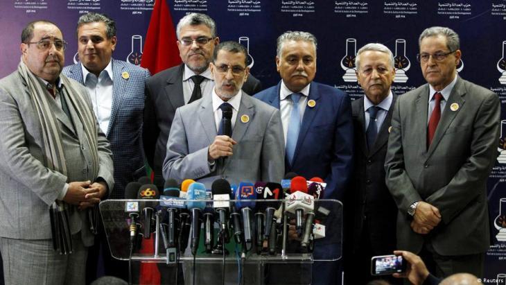سعد الدين العثماني غداة إعلان تشكيل الحكومة وقبوله بتكونها من ستة أحزاب عكس ما كان يريده عبد الإله بنكيران