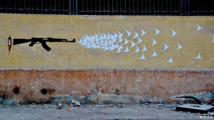 """""""آلة السلام"""" لفنان يحمل اسما مستعارا وهو """"الزفت"""". كتاب """"جدران الحرية"""" يعرض 750 صورة ورسما توثق لرسوم الغرافيتي لحوالي مائة فنان. وصودر الكتاب في مصر بدعوى احتواءه على مواد تشجع على العنف ضد السلطة."""