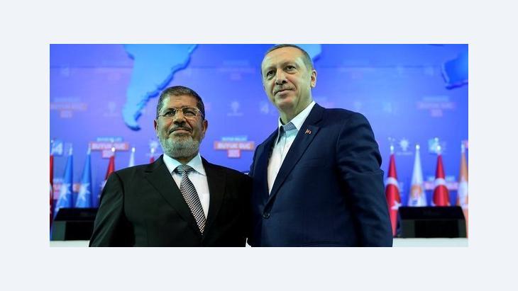 الرئيس المصري محمد مرسي ورئيس الوزراء التركي رجب طيب إردوغان. رويترز