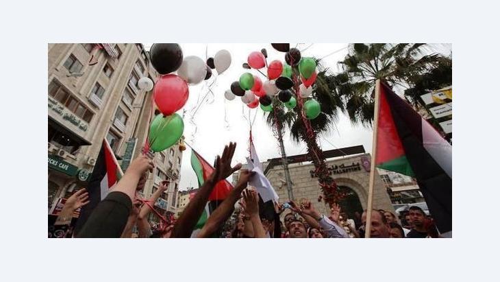 ارتياح فلسطيني باتفاق المصالحة الأخير بين حماس وفتح ولكن العبرة في التطبيق، الصورة د ب ا