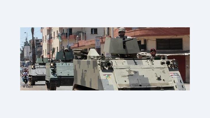 علاقات الجيوش بالسياسة في ظل الربيع العربي.....قمع الجيش المتظاهرين في سوريا
