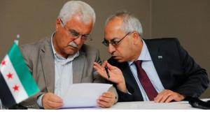 قياديان من قادة المجلس الوطني السوري المعارض، رويترز