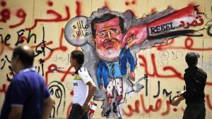 غرافيتي في القاهرة يستهزئ بالرئيس المعزول مرسي. غيتي إميجيس
