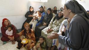 فعالية أقامها مركز التنمية والتدريب القبطي في منطقة بني سويف بمصر للتوعية حول موضوع ختان الإناث. Foto: CRIS BOURONCLE/AFP/Getty Images
