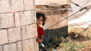 طفل سوري في مخيم للاجئين على الحدود السورية. Foto: dpa/picture-alliance