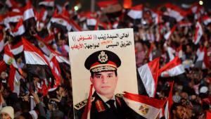أنصار وزير الدفاع عبد الفتاح السيسي في ميدان التحرير في القاهرة في الذكرى السنوية الثالثة لثورة يناير المصرية.   Foto: Reuters